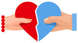 Female and male hand holding heart symbol of love. Two half heart