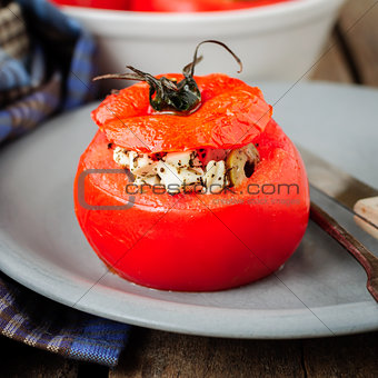 A Cheese and Green Olive Stuffed Tomato