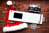 Christmas and New Year background with old fashioned camera, red