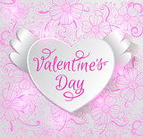 Paper heart on a pink floral background