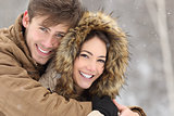 Couple with perfect teeth in winter
