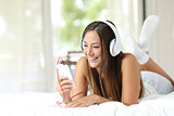 Girl listening to music from a smartphone at home