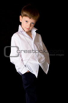 Portrait of the boy on a black background