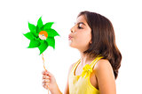 Girl blowing a windmill