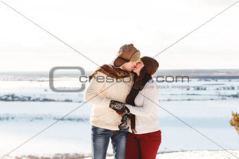 Beautiful girl and boy with husky dog in winter forest
