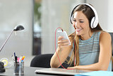 Girl listening music with smartphone and headphones