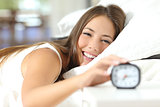 Happy woman waking up having a good day