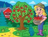 Farm girl with collected apples