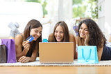 Friends shopping online with credit card