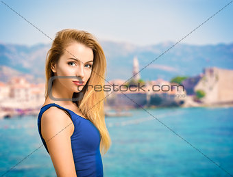 Portrait of Young Woman in Blue Top at Sea
