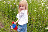 little girl with patriotic bouquet