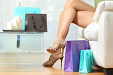 Fashion shopper legs with shopping bags