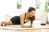 Fitness woman exercising watching fitness videos