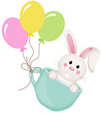 Easter bunny in teacup with balloons