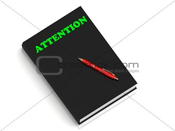 ATTENTION- inscription of green letters on black book