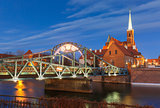 Tumski Bridge at night in Wroclaw, Poland