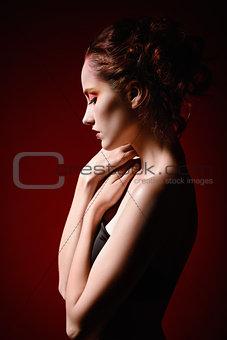 Portrait of beautiful sad redhead girl. Profile view