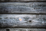 Dark old timbered wooden loghouse wall