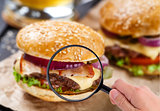 Magnifying glass examining burger