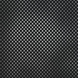 Perforated metal on carbon fibre background