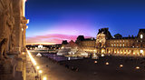 Pyramid of the Louvre Museum in Paris at sunset.
