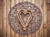 Handmade heart on wooden background
