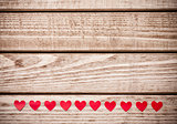 Multiple small red hearts on wooden background