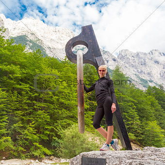 Active sporty woman relaxing in Vrata Valley, Slovenia.