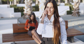 Attractive young woman chatting on a mobile