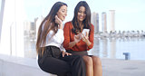 Young woman sharing a text message with friend