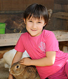 little girl with brown rabbit