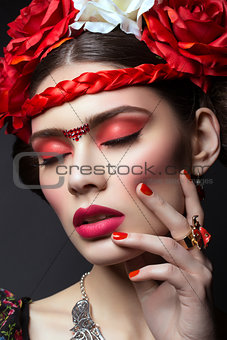 Beautiful girl with red lips and flowers