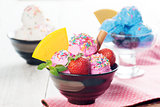 Pink, blue and white ice cream in bowl