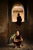 Buddhist novice monks inside temple