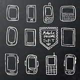 Hand drawn set of mobile gadgets on black chalk board