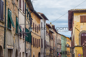 Old houses with blinds in the center of Volterra