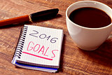 coffee and notepad with the text 2016 goals