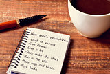 coffee and notepad with a list of new years resolutions