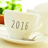 number 2016, as the new year, on a cup of coffee or tea