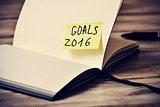 notepad with the text goals 2016, filtered