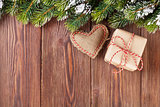 Christmas tree branch with gift box and heart toy