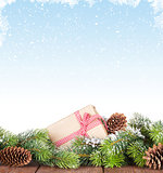 Christmas tree on wooden table with snow background