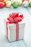 Christmas gift box and colorful baubles