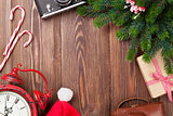 Christmas background with camera, alarm clock and tree branch