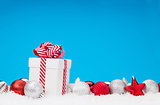 Christmas background with baubles and gift box