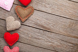 Valentines day background with handmade toy hearts