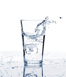 Glass of water with ice and splash