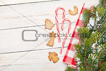 Christmas candy cane, gingerbread cookies and snow fir tree