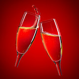 Two champagne glasses over red