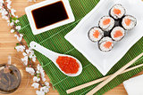 Red caviar, sushi set, sakura branch and green tea